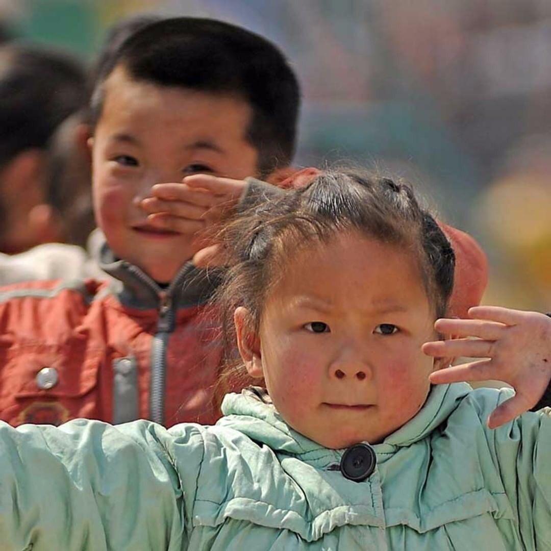 crianças praticando Tai Chi Chuan